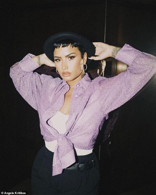 Honesto: Demi Lovato afirmó que `` casi llegó al cielo '' mientras reflexionaba sobre su casi fatal sobredosis de 2018 en la letra de su nuevo sencillo Dancing With The Devil, lanzado el viernes.