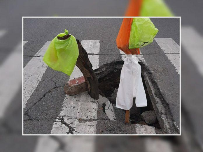 El hueco de los accidentes en plena 36 con Calle 5 en Cali