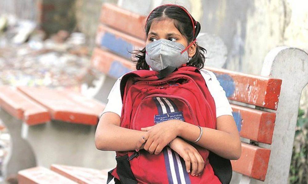 School girl with mask