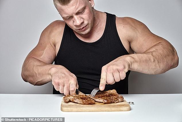 A los hombres les gusta comer más carne que las mujeres porque sienten que les ayuda a `` promulgar y afirmar su identidad masculina '', concluyó un estudio (imagen de stock)